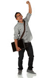 Young adult celebrating with hand in the air Stock Image