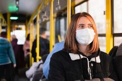 Free Young Adult Commutes In A Protective Face Mask. Stock Photo - 175338730