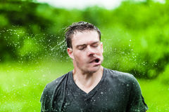Young Adult Completely Drenched Shaking His head Royalty Free Stock Image