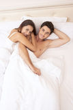 Young adult couple in bedroom Royalty Free Stock Images