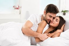 Young adult couple in bedroom Stock Image