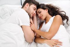 Young adult couple in bedroom Stock Photography