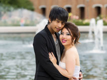 Young Adult Couple Closely Holding Each Other Stock Photos