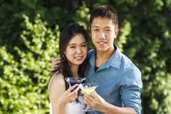 Young Adult Couple enjoying the warm day outdoors with a few dri Royalty Free Stock Photo