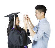 Young Adult Couple expressing happiness upon graduation Stock Images