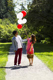 Young Adult Couple having Fun while going for a walk Royalty Free Stock Images