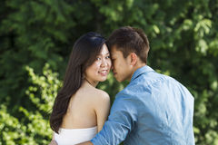 Young Adult Couple holding each other while outdoors Royalty Free Stock Image