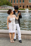 Young Adult Couple Holding Hands Near the Water Fountain Royalty Free Stock Photo