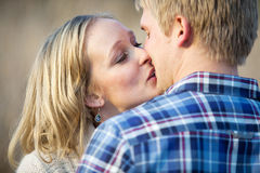 Young adult couple kissing outside in daytime Royalty Free Stock Photography