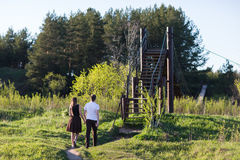 Young adult couple. In love walking at summer park, back view royalty free stock images