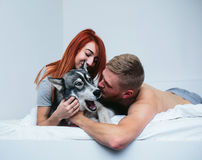 Young adult couple lying on bed Royalty Free Stock Image