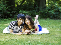 Young Adult Couple Lying on Blanket Outdoors Royalty Free Stock Photo