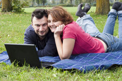 Young Adult Couple in the Park Royalty Free Stock Images