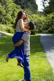 Young Adult Couple Playing Around while Walking Outdoors Royalty Free Stock Photos
