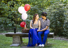 Young Adult Couple Preparing for an Outdoor Picnic Stock Photography