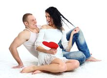 young adult couple with red heart on the floor Stock Photography