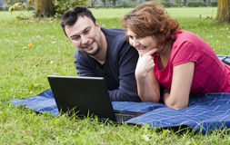 Young Adult Couple Relaxing in the Park Royalty Free Stock Photos