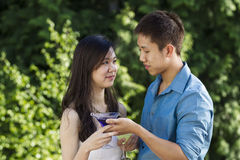 Young Adult Couple Sharing Drinks Outdoors Royalty Free Stock Image