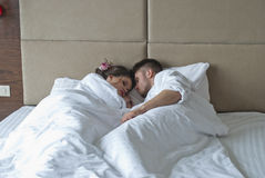 Young adult couple sleeping peacefully on the bed Royalty Free Stock Images