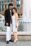Young Adult couple standing in front of water fountain Royalty Free Stock Images