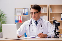 The young adult doctor with laptop computer Royalty Free Stock Photo