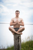 Young Adult Doing Yoga on a Stump in Nature Stock Photos