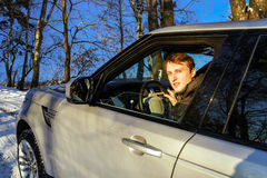 Young adult driver of 4x4 offroader portrait Stock Photos