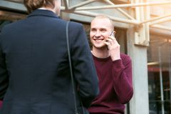 Young adult entrepreneurs people have business meeting talking on the street and making phone call. S Stock Image
