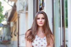 An young adult female is looking with an angry expression. royalty free stock photo