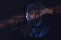 Young adult female monk in shaft of lights Stock Image