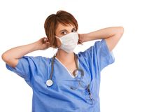 Young adult female nurse prepping for surgery Royalty Free Stock Photos