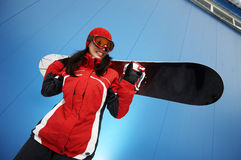 Young adult female snowboarder stock photography