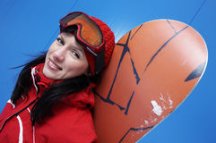 Young adult female snowboarder Stock Photo