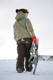 Young adult female snowboarder Stock Images