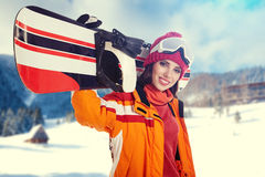 Young adult female snowboarder. Royalty Free Stock Images