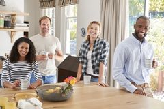Young adult friends having coffee at home, looking to camera stock photos
