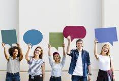 Young adult friends holding up copyspace placard thought bubbles royalty free stock photo