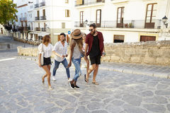 Young adult friends on holiday sightseeing in Ibiza, Spain Royalty Free Stock Images