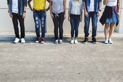 Young adult friends standing together. Youth culture concept royalty free stock image