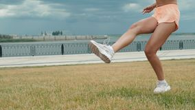 Young adult girl close up playing football or soccer, kicking a ball with her knee Beautiful brunette woman in a sports. Young adult girl playing football or stock footage