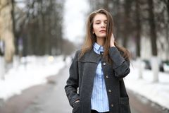 Young adult girl in coat on the street Stock Image