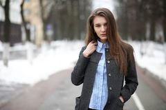 Young adult girl in coat on the street Royalty Free Stock Image