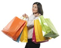 Young adult girl with colored bags Stock Images