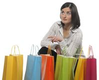 Young adult girl with colored bags Royalty Free Stock Photos