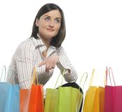 Young adult girl with colored bags Stock Image