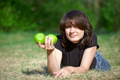Young adult girl holding two apples in hand Stock Image