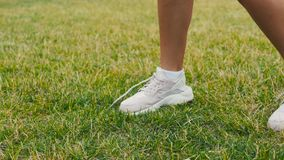 Young adult girl close up playing football or soccer, kicking a ball with her knee Beautiful brunette woman in a sports. Young adult girl playing football or stock video