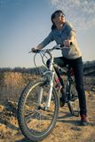 Young adult girl resting in biking trip Stock Photos
