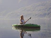 Young woman kayaking on the lake royalty free stock image