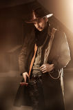 Handsome man in cowboy clothes. Young adult handsome man in cowboy clothes Stock Photos
